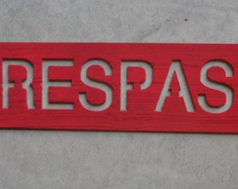 Metal NO TRESPASSING SIGN in red distressed with baked on clear coat