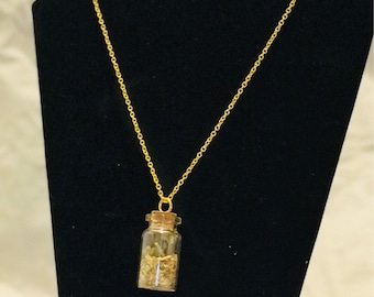 Natural and fresh dried herb protection bottled necklace spell jar