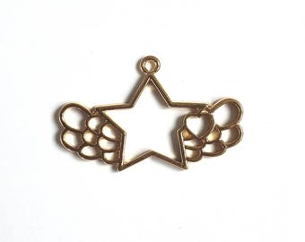 Gold metal wings and star pendant