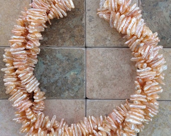 Just reduced peach colored freshwater pearls