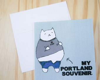"""CARD: """"Portland Foodie"""" featuring a cat with a food baby"""