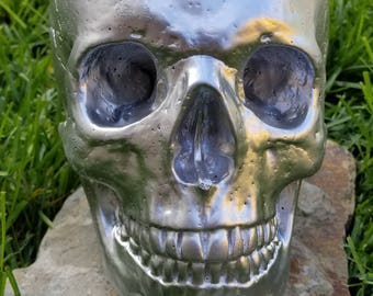 Realistic life size painted concrete skull - silver