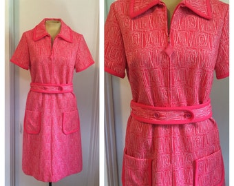 Belted knit dress in coral and white pattern