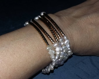Set of 5 fresh water pearls with gold field tube