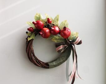 Pomegranate wreath, harvest wreath of red pomegranates, polyester, life size, small pomegranates on wicker wreath with colourful ribbons