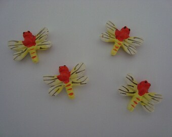 Set of four dragonflies in shades of orange for decoration