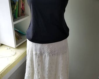 White lace skirt....wide elastic waistband...two layers....crocheted lace