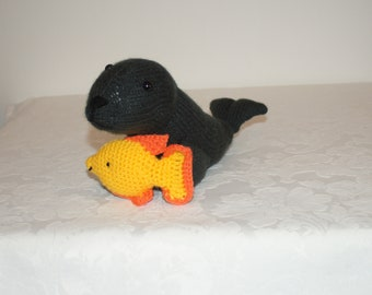 Hand knitted sea lion with his friend the little fish by Liz