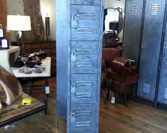 Vintage industrial stripped steel factory lockers