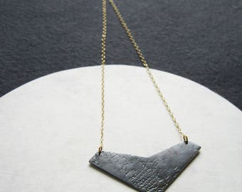 Oxidised silver lace textured geometric chevron pendant on fine gold-filled chain