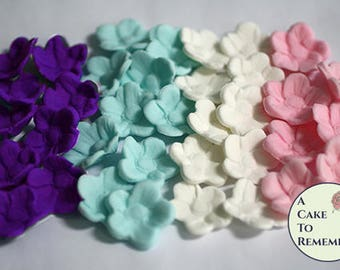 20 fondant flowers for unicorn cakes and edible cupcake toppers. Small blossoms for cake pops, macarons. Edible unicorm cake decorations