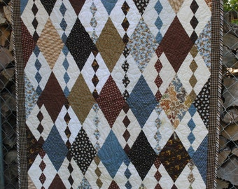 Handmade quilted throw in argyle/diamond pattern, in earth tones, brown, beige, white, blue, dusty blue, rust.