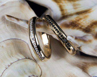 Wedding Rings/wedding rings from 585 gold with white and black diamonds