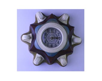 Scroll and Star Clock - Subdued blue, red and cream