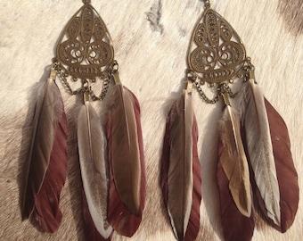 Ornate feather earrings
