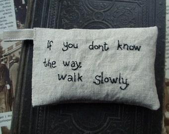 Lavender sachet in linen with embroidered text 'If you don't know the way walk slowly'