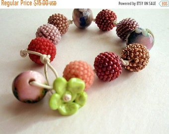 Half Price One week sale Beaded Beads in Shades of Pink with Handmade Glass Beads Bracelet
