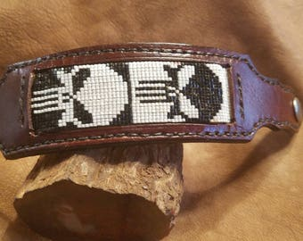 Handmade beaded leather bracelet - black and white skulls