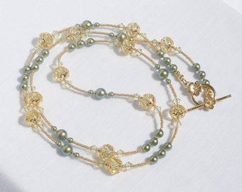 Swarovski jonquil crystal and iridescent green pearl long necklace