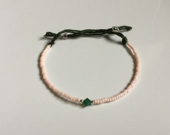 Petite stretchy friendship bracelet in soft pink with an opal green Swarovskistein
