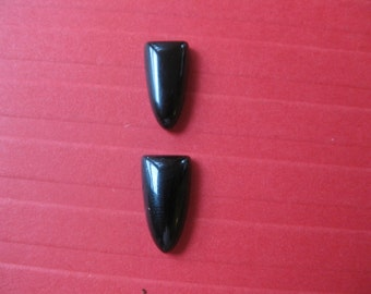 A pair of Black onyx Tongues Cabochons