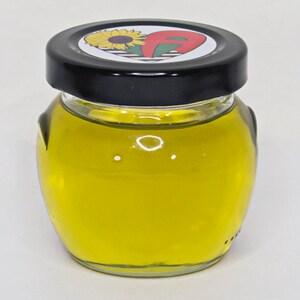 Hair Elixir- Sweet Almond oil, Jojoba oil, Olive oil, Tea Tree oil, Rosemary oil, Lemongrass, Vitamin E- for hair growth, dandruff, itchy