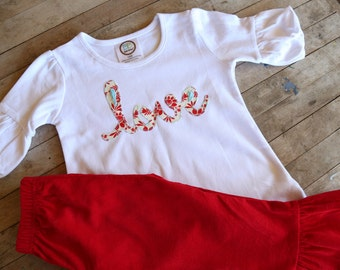Love top with red ruffled pants