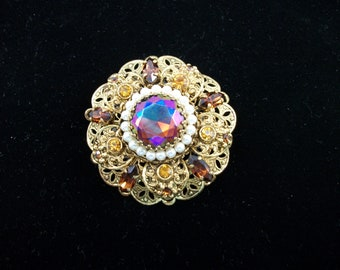 SALE  Vintage gold tone and topaz rhinestone brooch.