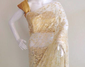 Gold and white lace saree with a gold blouse