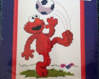 Elmo Soccer Cross Stitch Kit Janlynn Sesame Street  Elmo from Sesame Street is kicking a soccer ball.