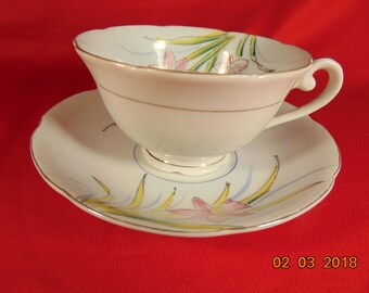 "One (1), 2 1/8"", Porcelain, Footed Tea Cup & Saucer, from Occupied Japan, Signed with a Cherry Blossom Variant Logo."