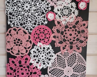 Table decorated with doilies and granny crochet