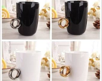 Ceramic stick cup holders. They can stick anywhere on your coffee mug or tea cup to give you better grip