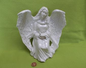 Blue White Sitting Angel holding Dove