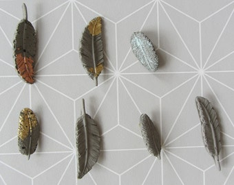Concrete feather brooch