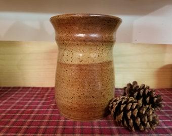 Light rust pottery utensil holder