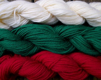 300 yards worsted weight yarn, white, green and red