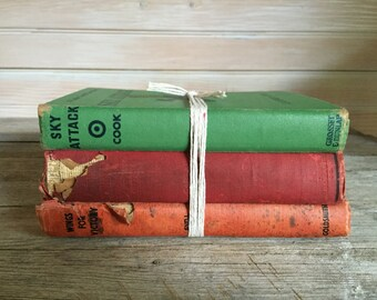 set of three old books