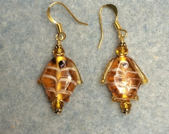 Amber lampwork fish bead dangle earrings adorned with amber Chinese crystal beads.