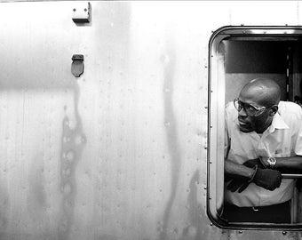 Subway conductor, NYC.