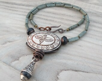 Eyes of Buddha Necklace with Stone  Necklace with Carved Bone Pendant and Lapis Lazuli