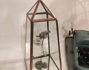 Handmade found object reclaim bird sculpture in a glass, mirrored bottom terrarium, curiosity steampunk vintage watch parts ornament