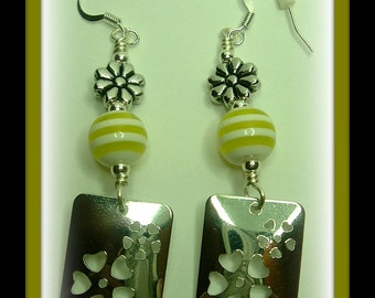 Wire wrapped stamped metal yellow floral dangle earrings