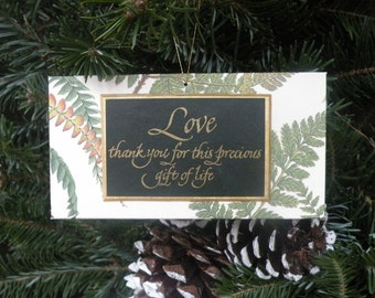 Precious Gift, a hand-crafted ornament with archival materials; made of approximately 70% recycled material