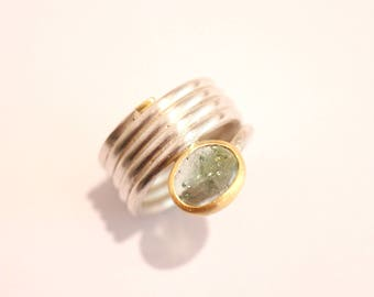 Silver and gold ring with green tourmaline coil ring