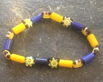 Blue and yellow glass beads with glass suns/lampwork beaded stretchy bracelet