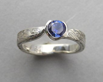14kt white gold and sterling silver Mokume-gane engagement ring set with Sapphire