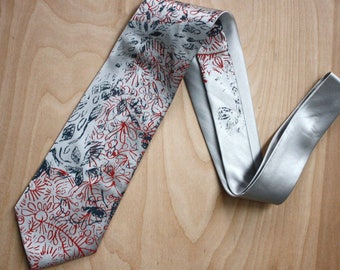 Hand printed Silk Necktie in light silver silk with floral print in blue-grey and red, original and one of a kind