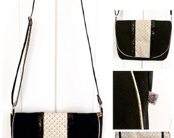 Black and gold suede satchel handbag