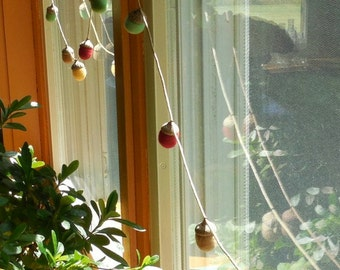 felted acorn garland - 12 felted acorns strung on a cotton cord - choice of colors